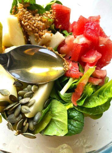 Adding of honey, seeds in salad