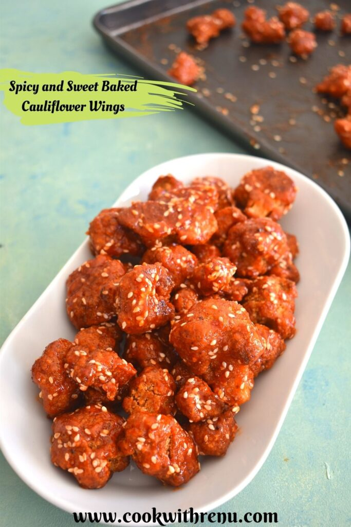Baked Spicy and Sweet Cauliflower Wings served in a white plate. Seen in the background is a black tray with more baked buffalo wings