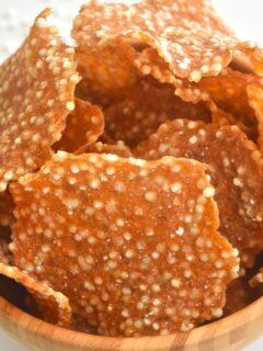 A brown bowl filled with farali aloo sabudana papad