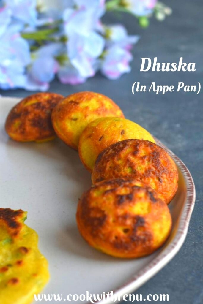 Close up view of Dhuska appe served on a white plate