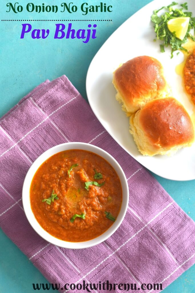 Pav Bhaji being served in a white bowl laid on a pink napkin. Seen along side are some pav.