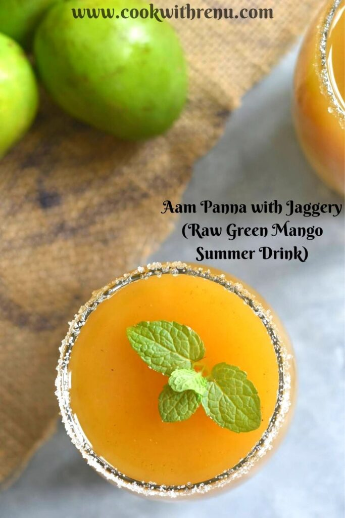 Top View of Aaam Panna with Jaggery served in a glass. Seen are some green raw mango on the sides