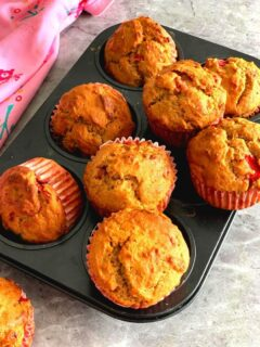 Eggless Strawberry Muffins seen on a muffin tray