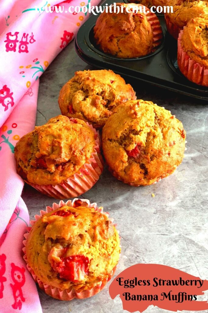 Eggless Strawberry Muffins seen on a muffin tray as well as on a table with a stole beside it