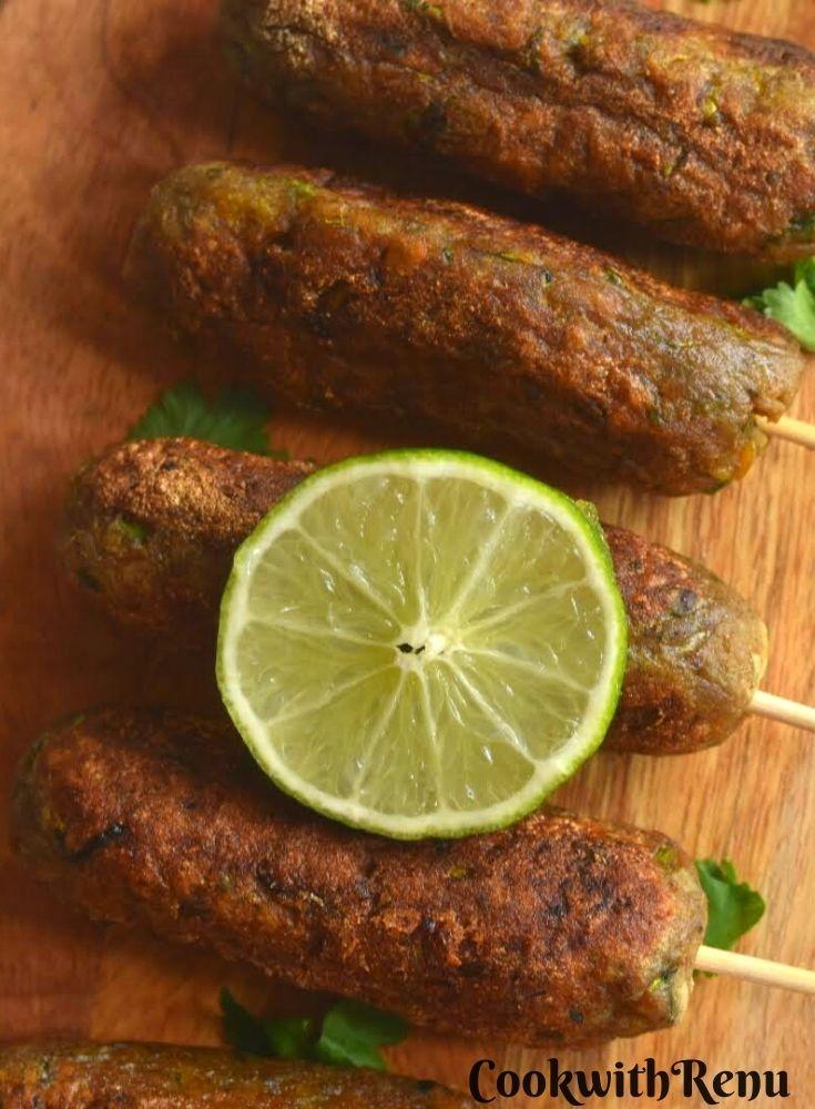 Close up look of Vrat ke kebab arranged on a wooden board with a garnish of lemon.