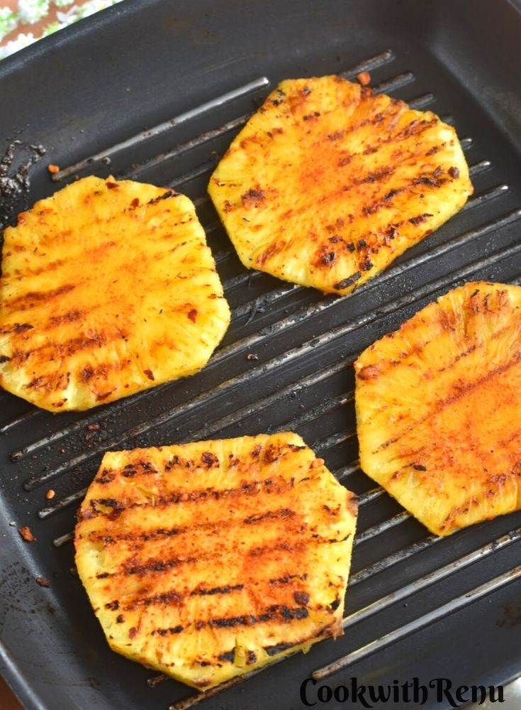 Peri Peri Grilled Pineapple on a grilled pan