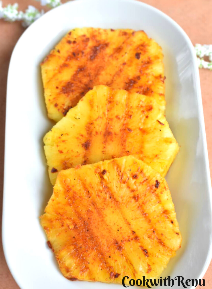 Peri Peri Grilled Pineapple served on a white plate
