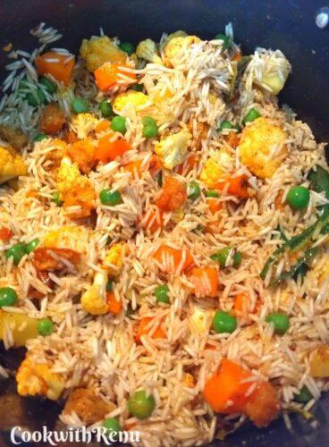 Mixing of vegetables, Mangodi, masalas and rice