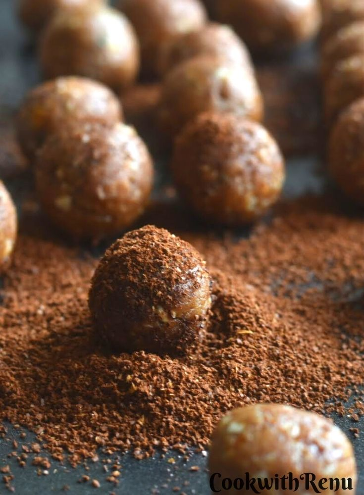 A close up look of one of the energy bites, dusted with coffee powder