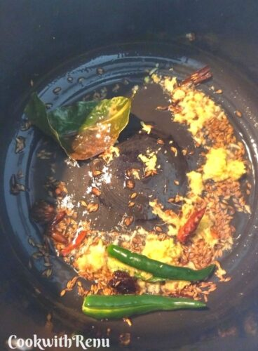 Adding of ginger and green chilli in the tadka